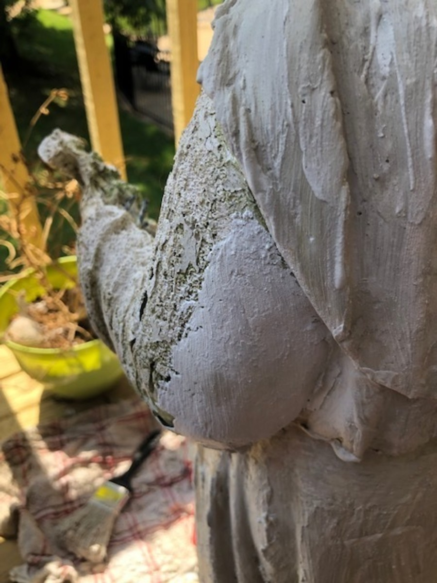 The difference between an area with no plaster and an area that has been filled in with plaster on a statue.