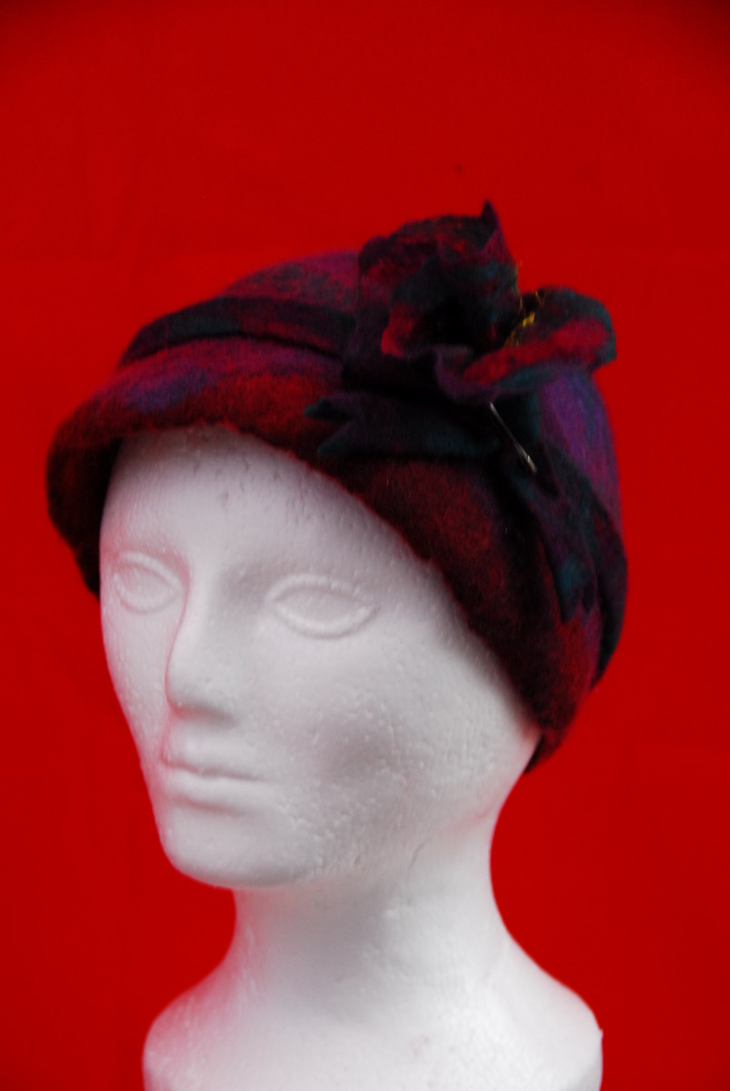 Completed hat along with matching felt flower and hat band.  Still a little wet from shaping.