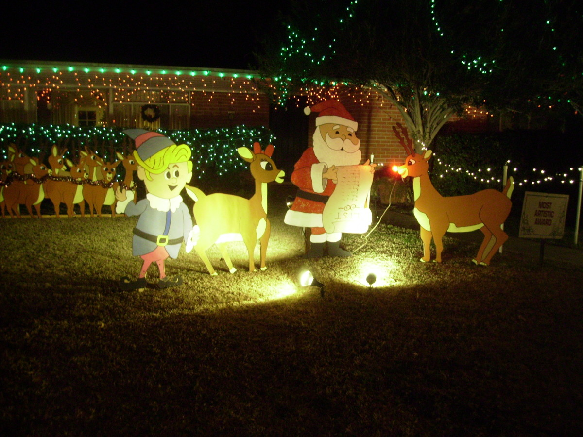 Christmas Lawn Decoration featuring Santa Claus, His Reindeer Rudolph and an Elf