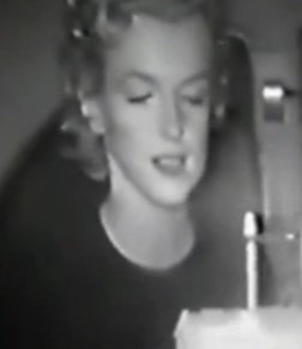 A rare image of Marilyn Monroe on her 30th birthday in the back of a car.