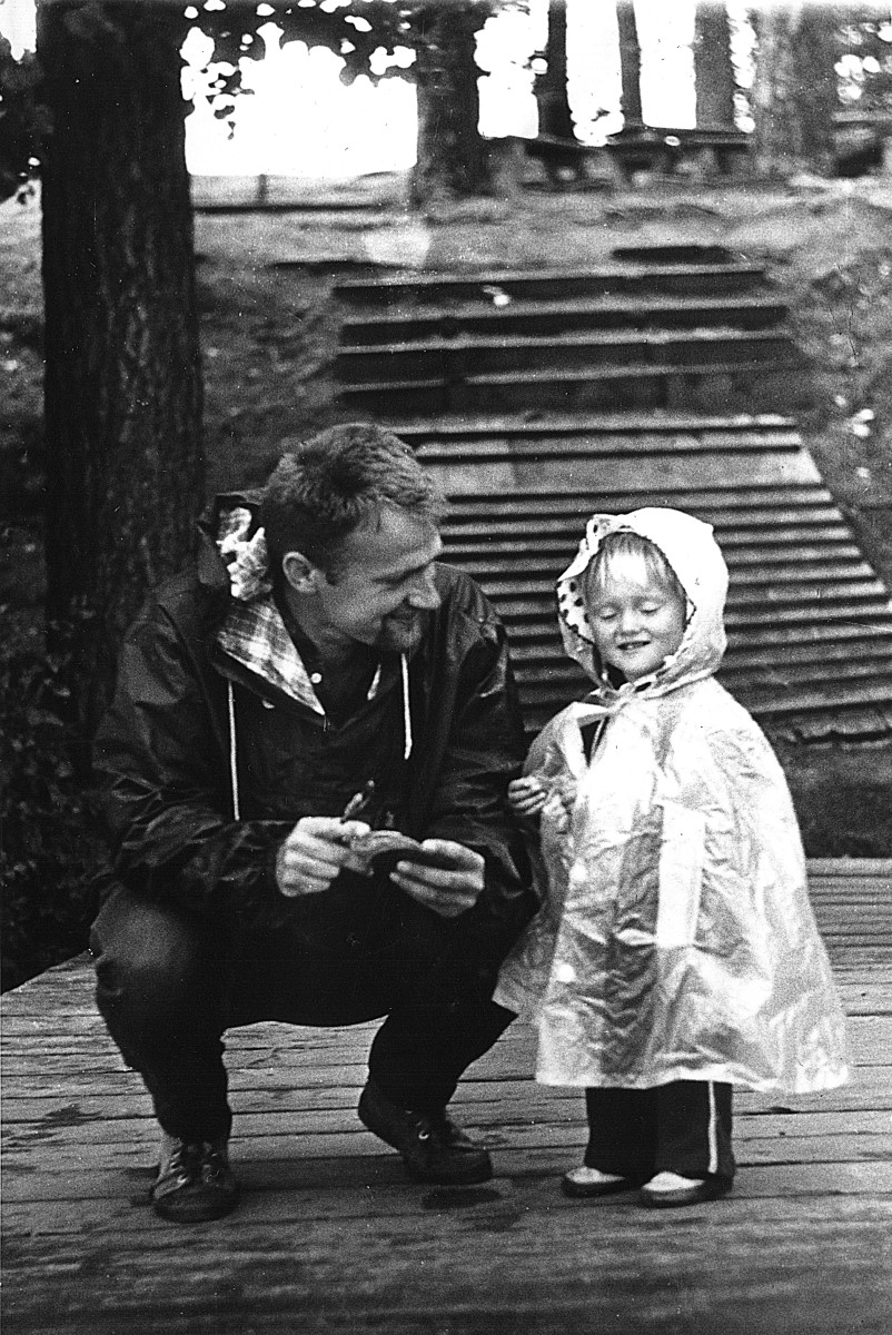 Black and white still of father and child