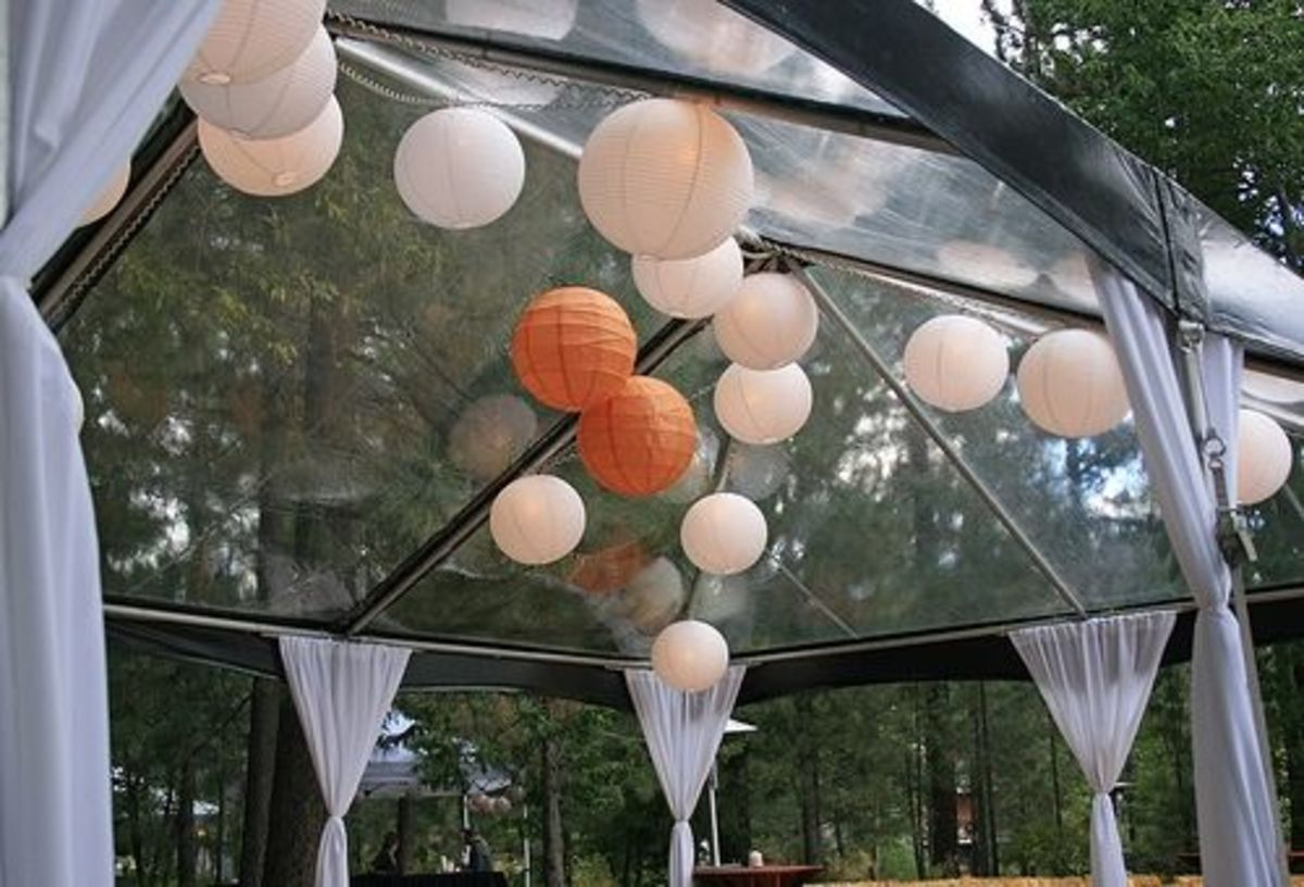 Sweet clear-top frame tent with funky ball lights (yeah these are super-popular) and perimeter pole drapes. Pole drapes are pretty inexpensive (maybe $10-20 each) and they really dress up the tent.