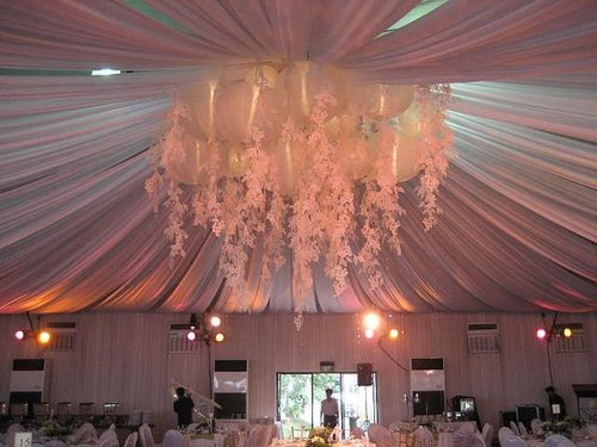 Elaborate tent lighting centerpiece over a tent liner
