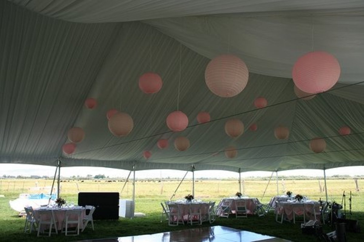 Lined tent with pink ball lights.