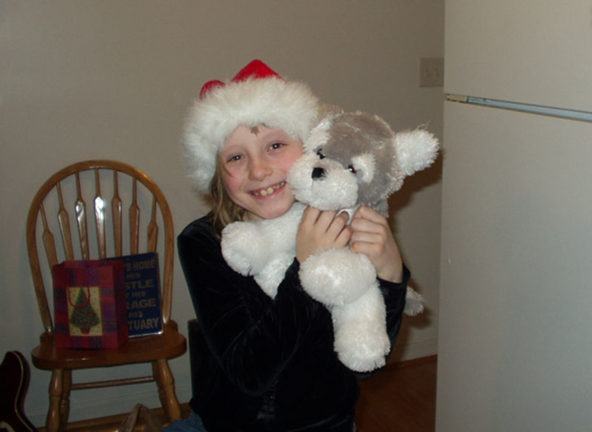 Lacey loves her wolf stuffed animal she received as a gift.
