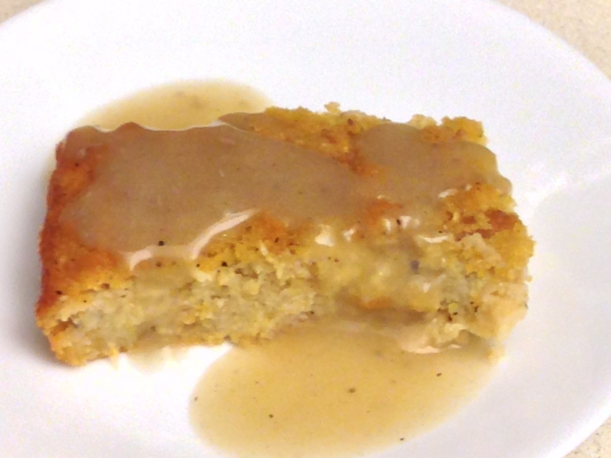 Cornbread dressing with sweet onion, topped with gibblet gravy
