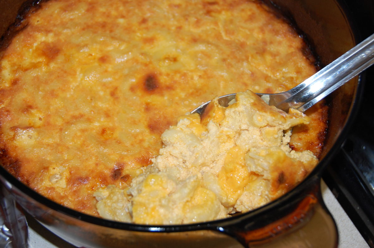 Real mac & cheese has milk & eggs, and is baked in the oven.  Fresh out of the oven, it has a souffle-like texture.