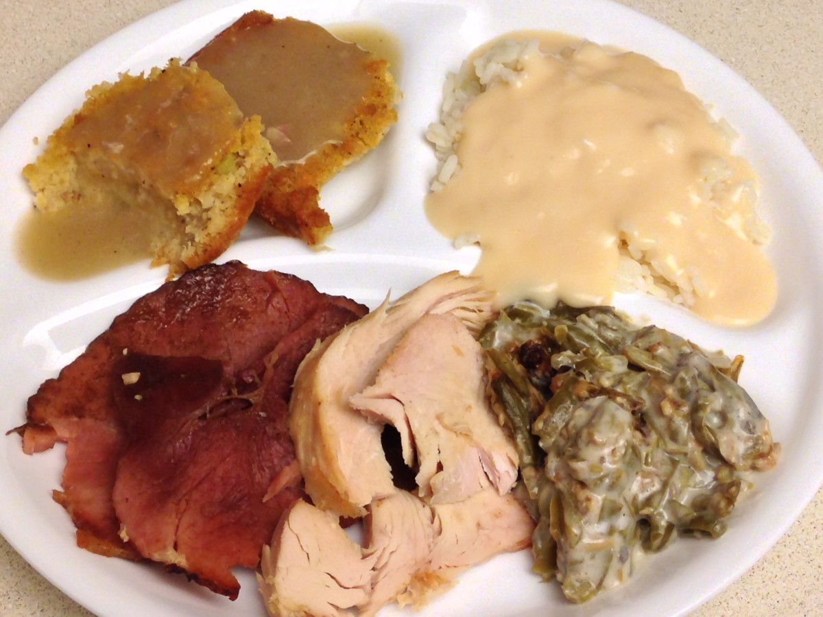 Maple glazed ham, roasted turkey, green bean casserole, rice with ham milk gravy, and cornbread dressing with gibblet gravy