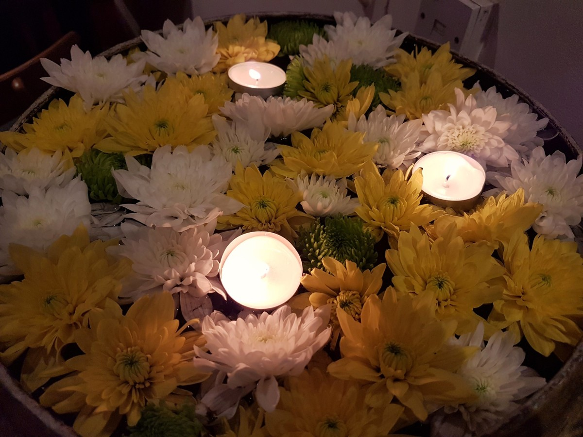 Candles and flowers are the two most popular offerings used by Halloween revelers to honor the dead in the Philippines.