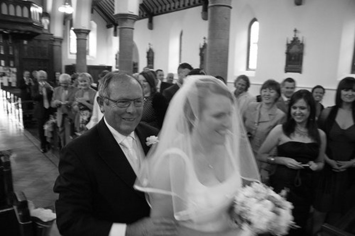 Many Catholic brides choose to wear the traditional bridal veil.
