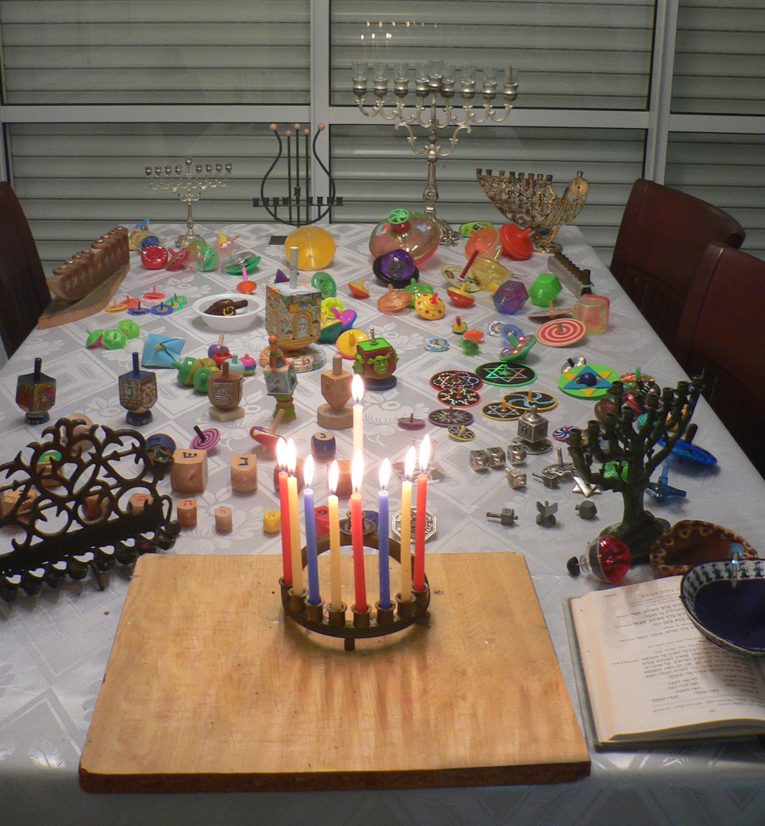 The menorah and dreidel are traditional Hanukkah objects.