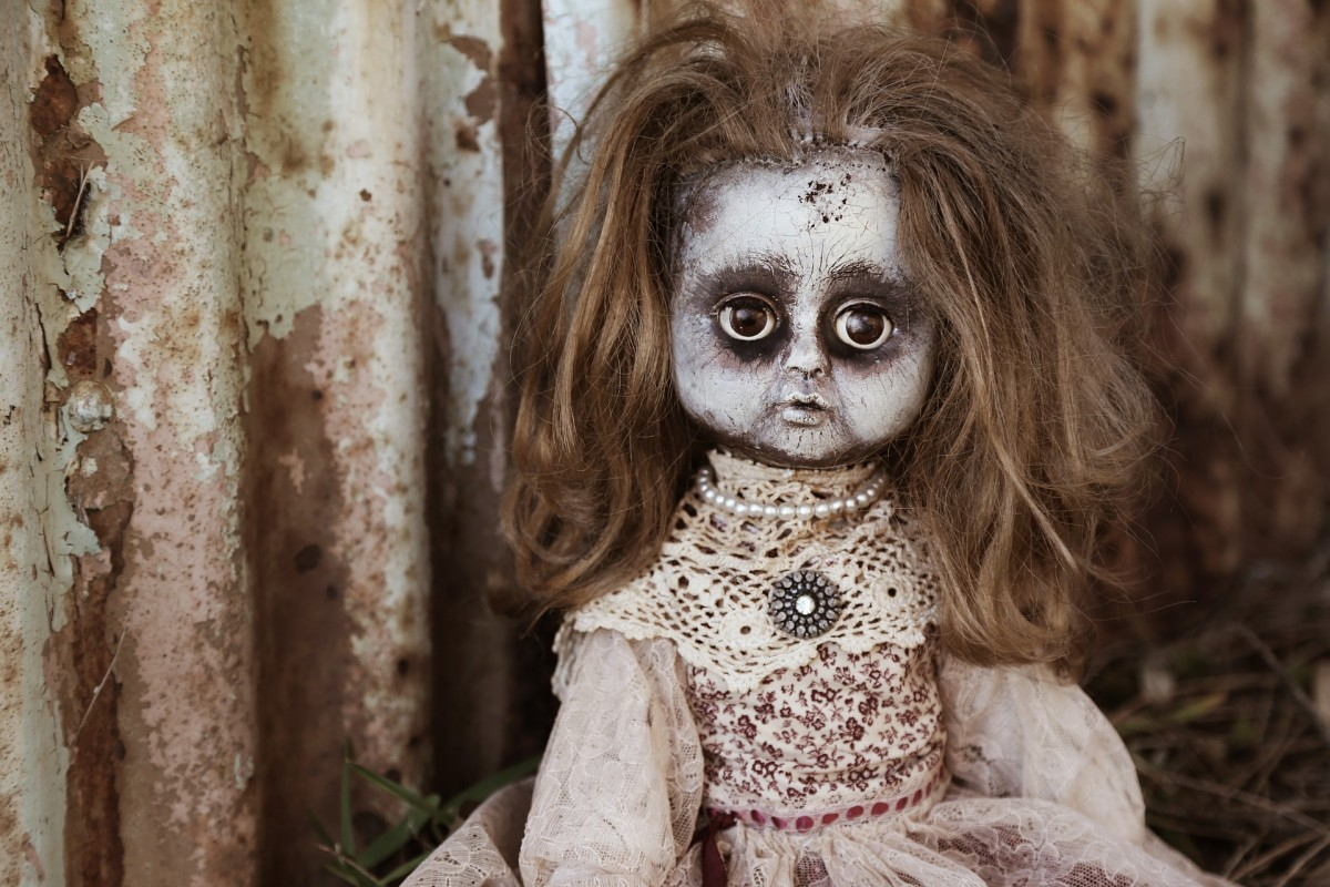 Use makeup, paint, flour, etc. to turn a regular doll into a zombie doll.