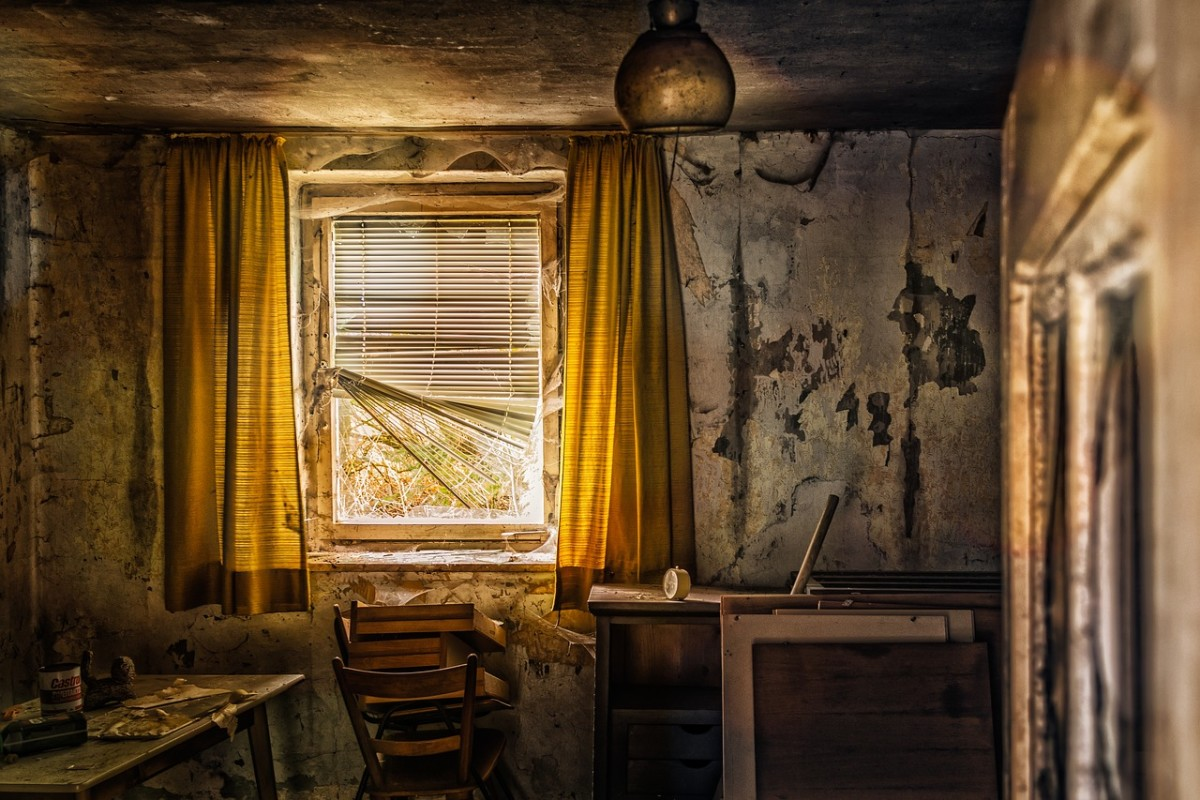 Shabby, long-abandoned rooms are creepy. Have a rat scuttle across the floor and a bat flap across the room.