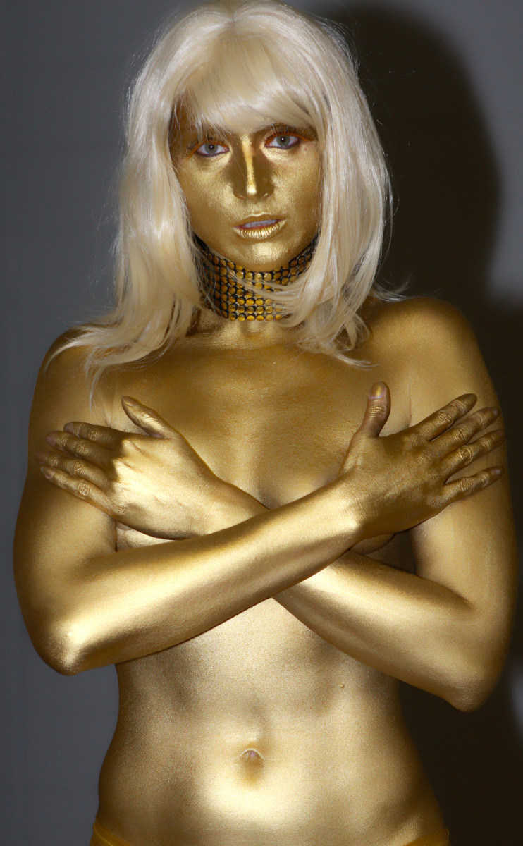 Consider painting yourself gold and going to the party as the poor girl who gets dipped in Goldfinger.