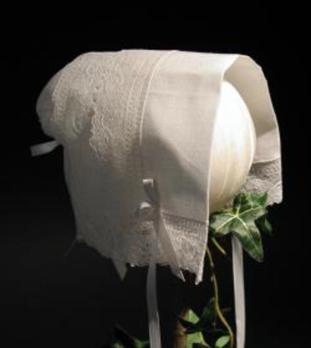 "The ""magic hankie"" can be carried by the bride and later made into a Christening bonnet for the first baby."
