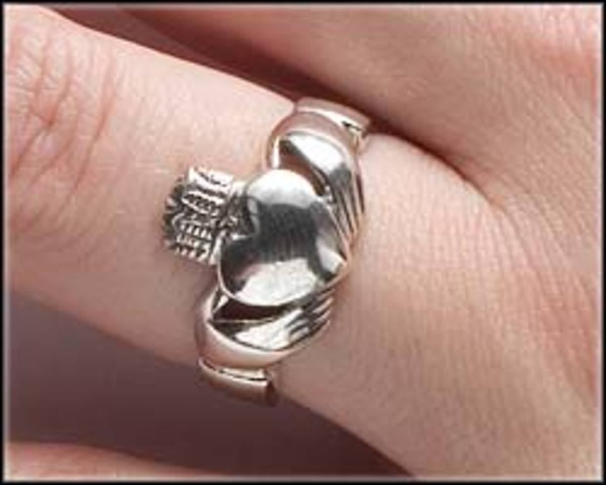 A claddagh ring worn on the left ring finger with the crown pointing to the fingertip shows the wearer is married.