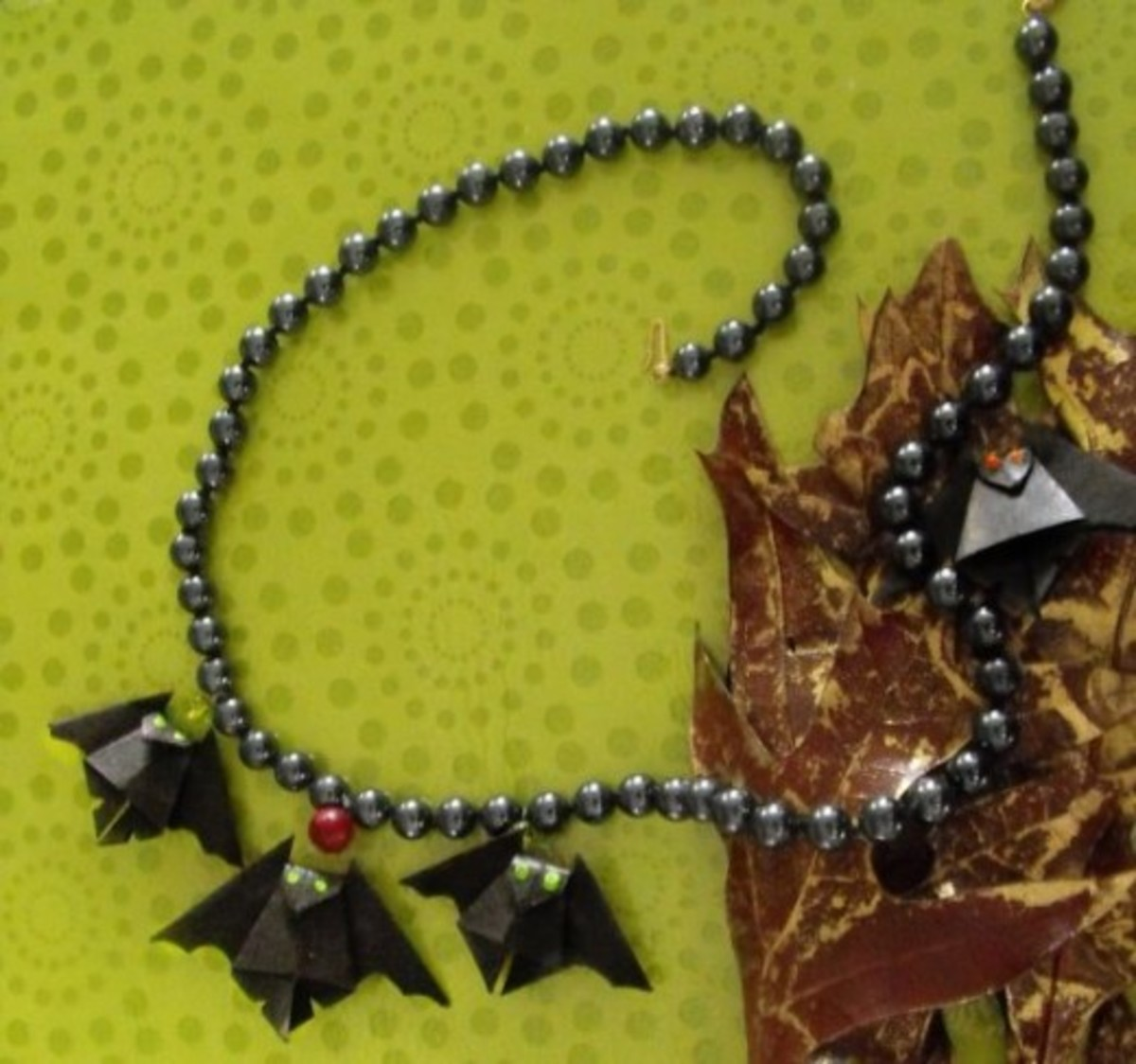 I made little bats and attached them to a necklace for wearing during the Halloween season.