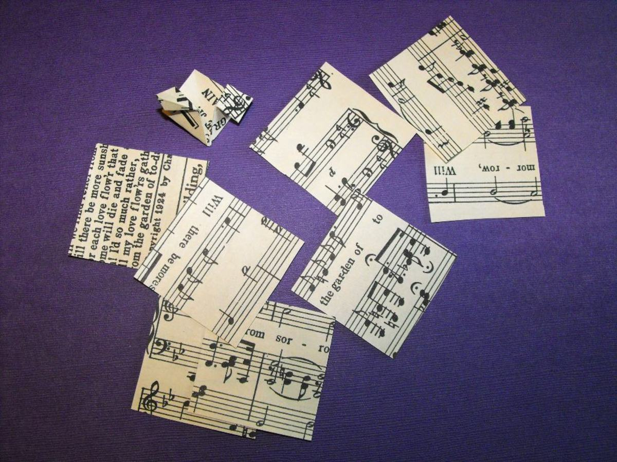 Cut eight 2 inch squares or tiles from old music paper.