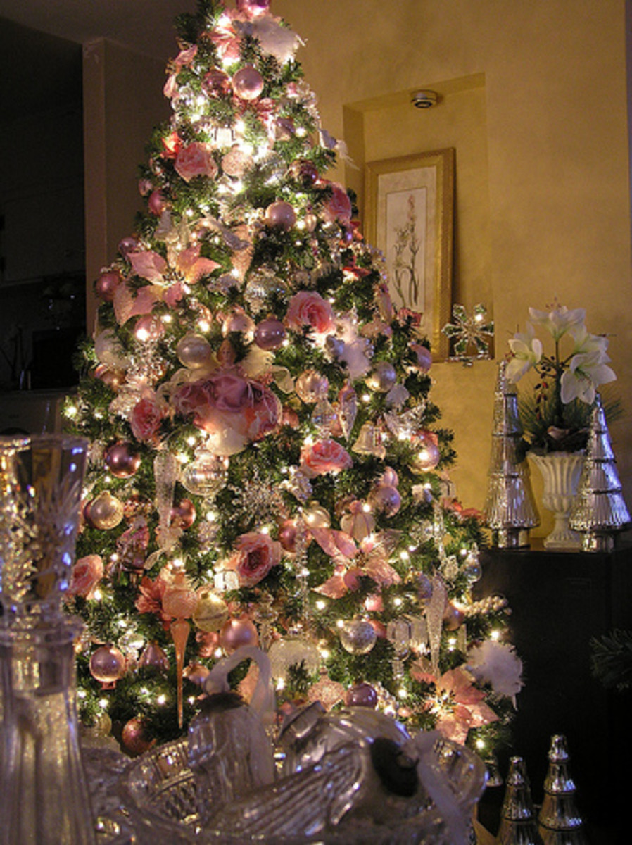 blue and gold ribbon and peacock ornaments will cap off this uniquely different tree - How To Decorate Pink Christmas Tree