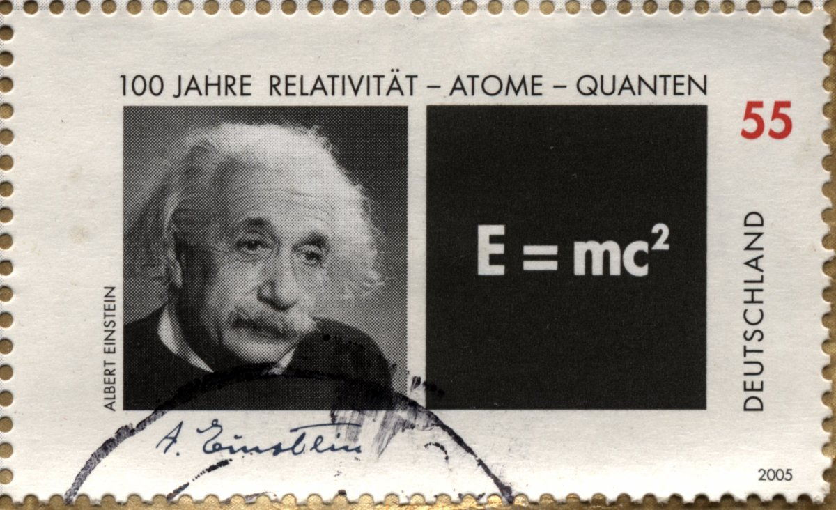 This aged stamp shows Einstein next to his most recognizable equation—the equation of mass-energy equivalence.