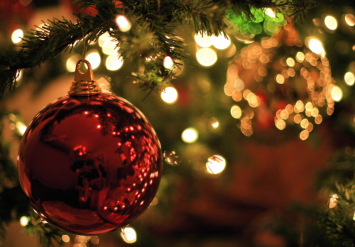 Shiny Baubles Entwined with Fairy Lights Brighten a Christmas Tree