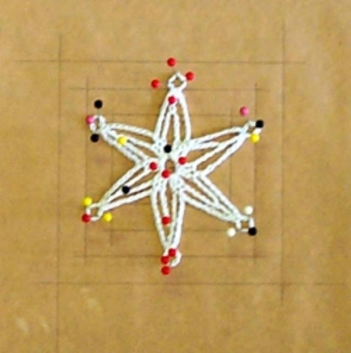 Blockign Crochet Snowflake Ornament - Photo by Mona Majorowicz