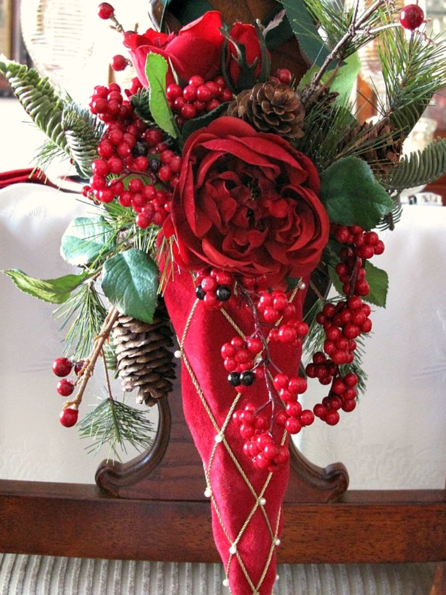 A  Victorian Tussie-Mussie Of Red Roses And Pine