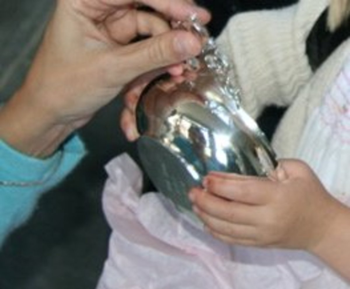 The bottom side of a porringer is a perfect place to engrave a message to the child getting baptised. The message should include the date of the Christening.