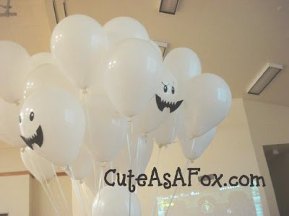 These Boo balloons have paper mouths and drawn-on eyes.