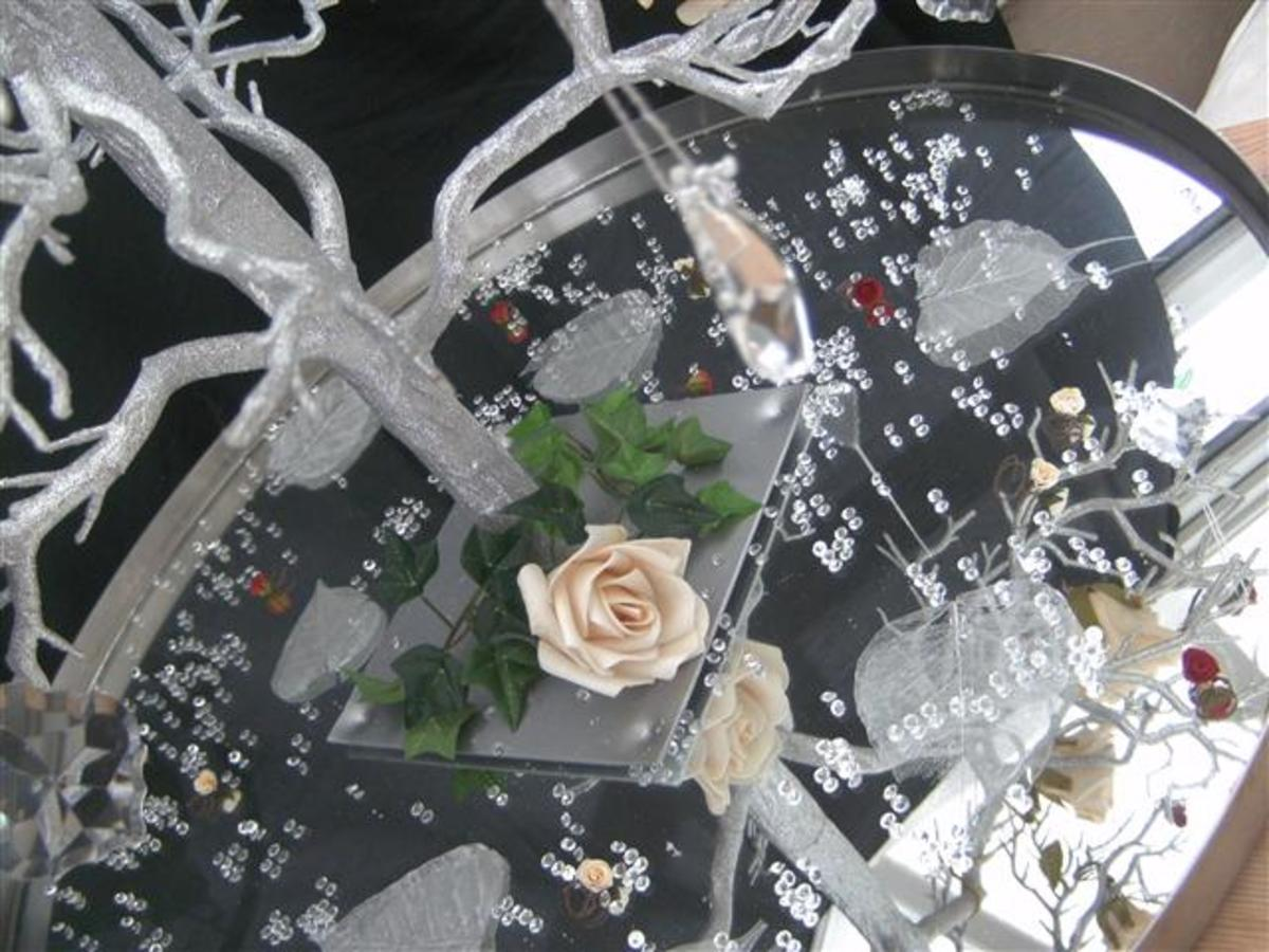 Decorate the base of your tree with flowers and crystals.
