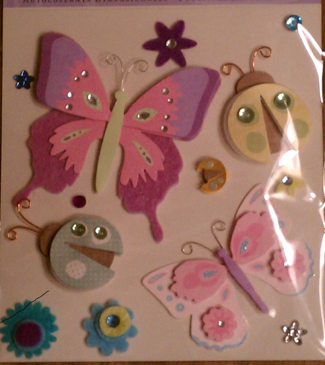 Scrapbooking stickers are a great way to customize the cake, and the mom can reuse them.