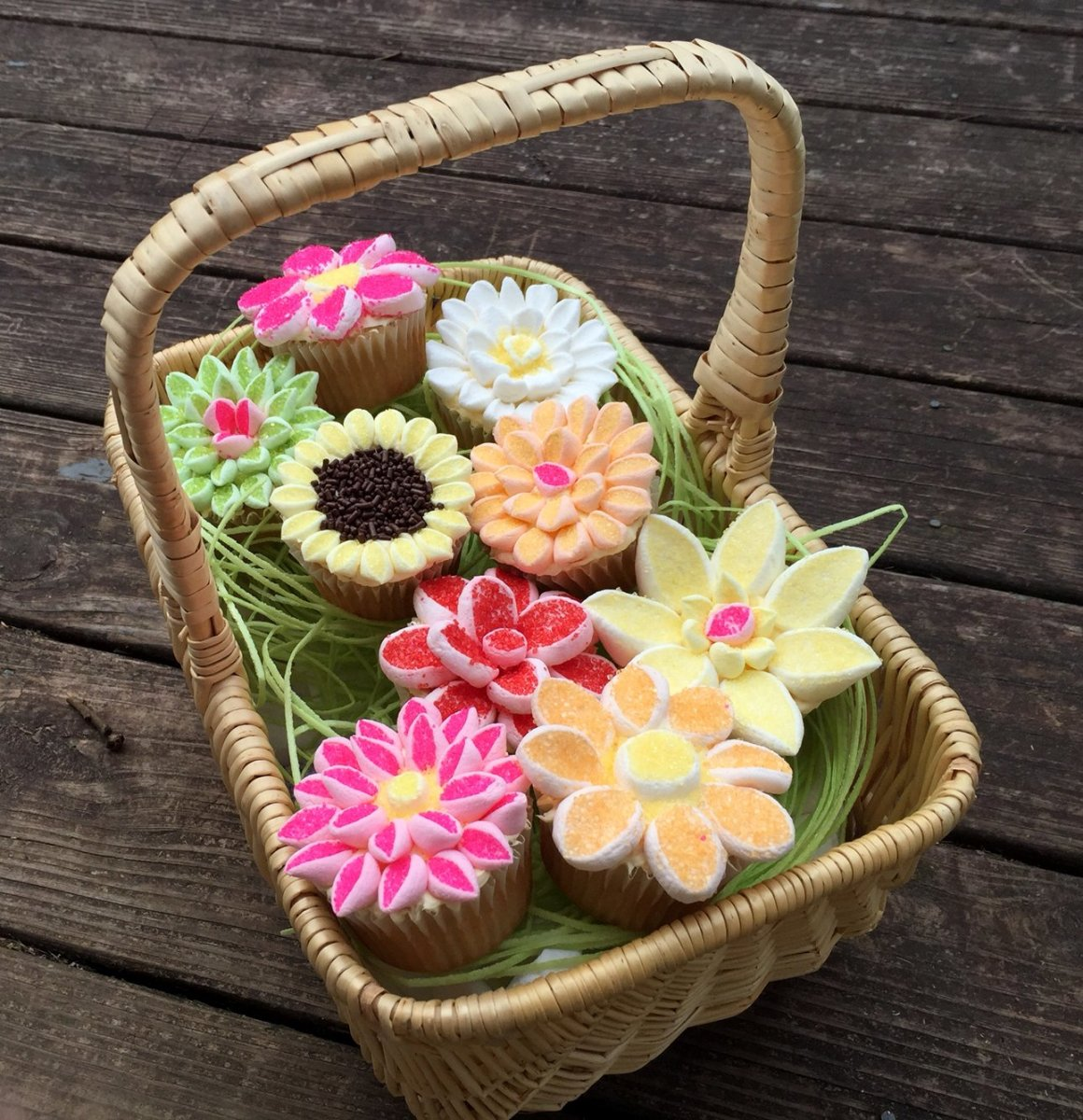 Marshmallow decorated cupcakes that look like pretty flowers are perfect substitute for a Mother's Day bouquet.