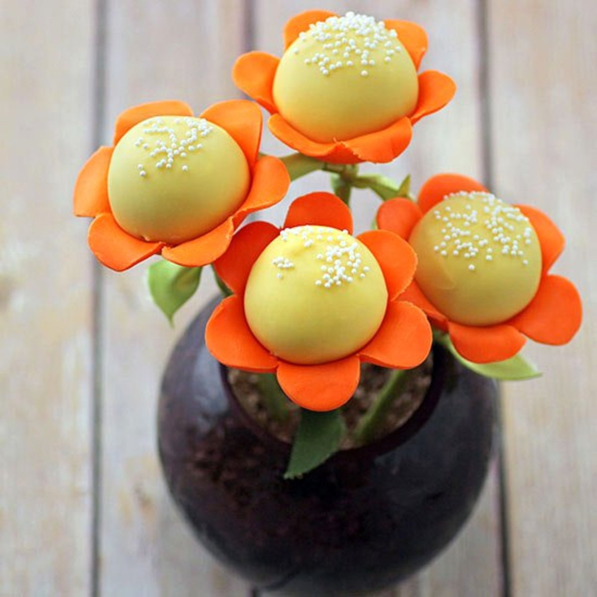 Last-minute Mother's Day gift idea—make cake pops flowers in minutes by using donut holes and fondant.