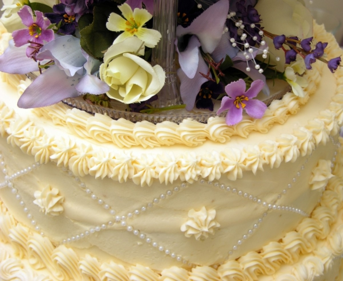 Delicate Hues for a Spring or Early Summer Wedding: Fresh Flowers Decorate a Special Spring Wedding Cake.