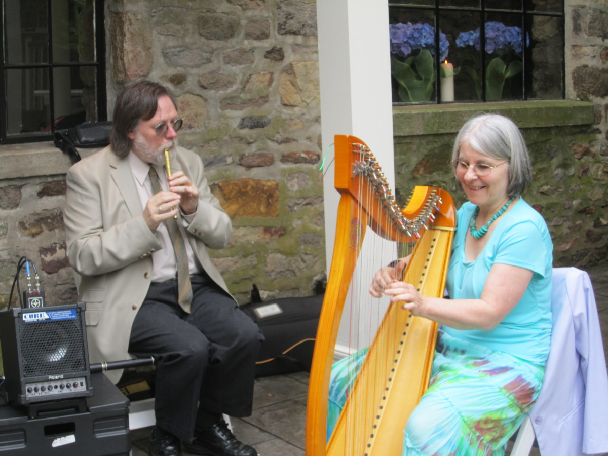 Kathy and her husband made our ceremony amazing. She played the harp with he played a tin flute.