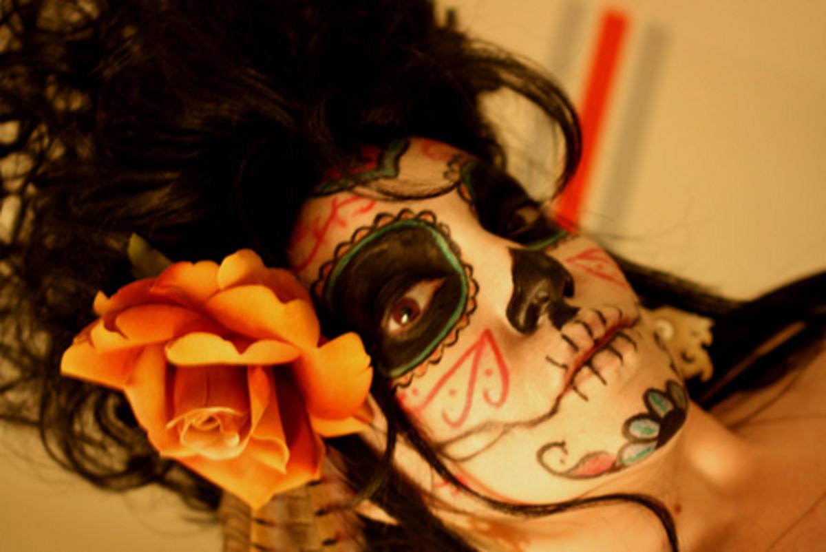 Dia de los muertos face-painting often mixes skulls with flowers.