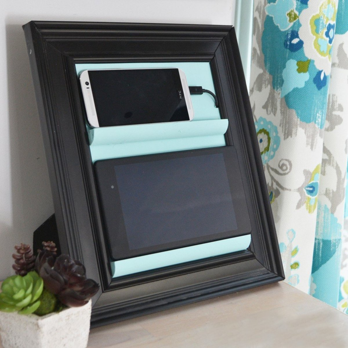 Charging station for electronic gadgets made from simple photo frame.
