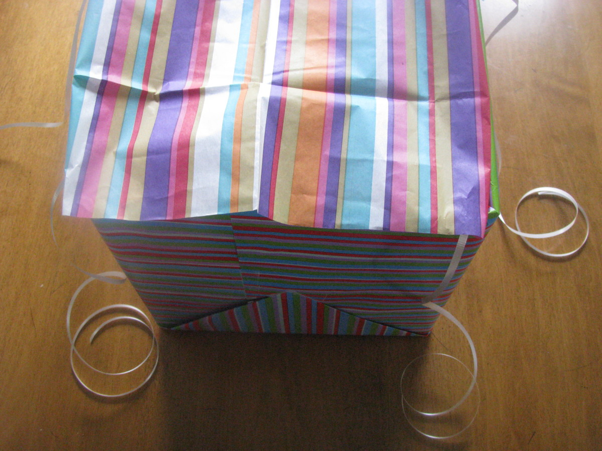 Step Five I tucked the edges of the tissue paper in the box and lightly taped them to the flap of the box.