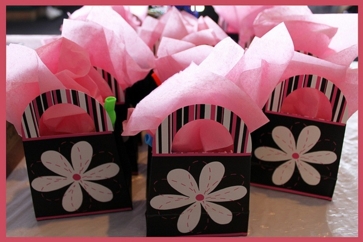 A little more ambitious than brown paper bags, but a very nice way to package party favors!
