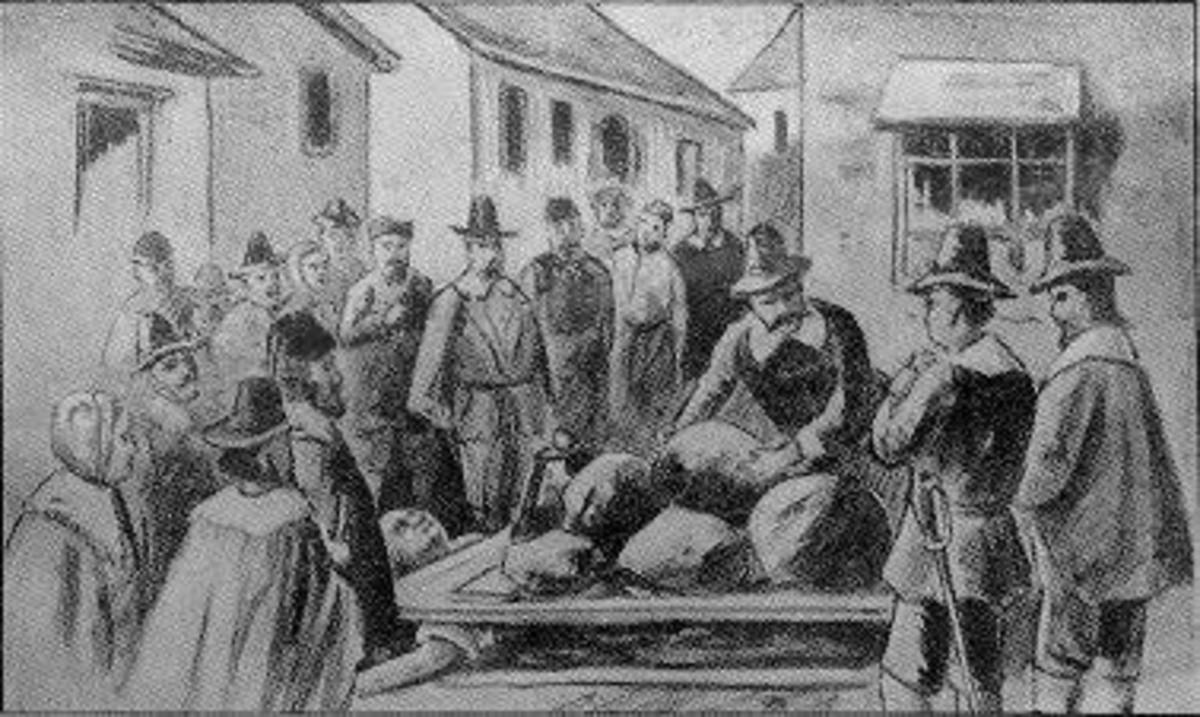 Giles Corey (died Sept. 19, 1692). Pressed with heavy stones for failing to answer a charge of witchcraft. He lay between the boards shown and was pressed to death.