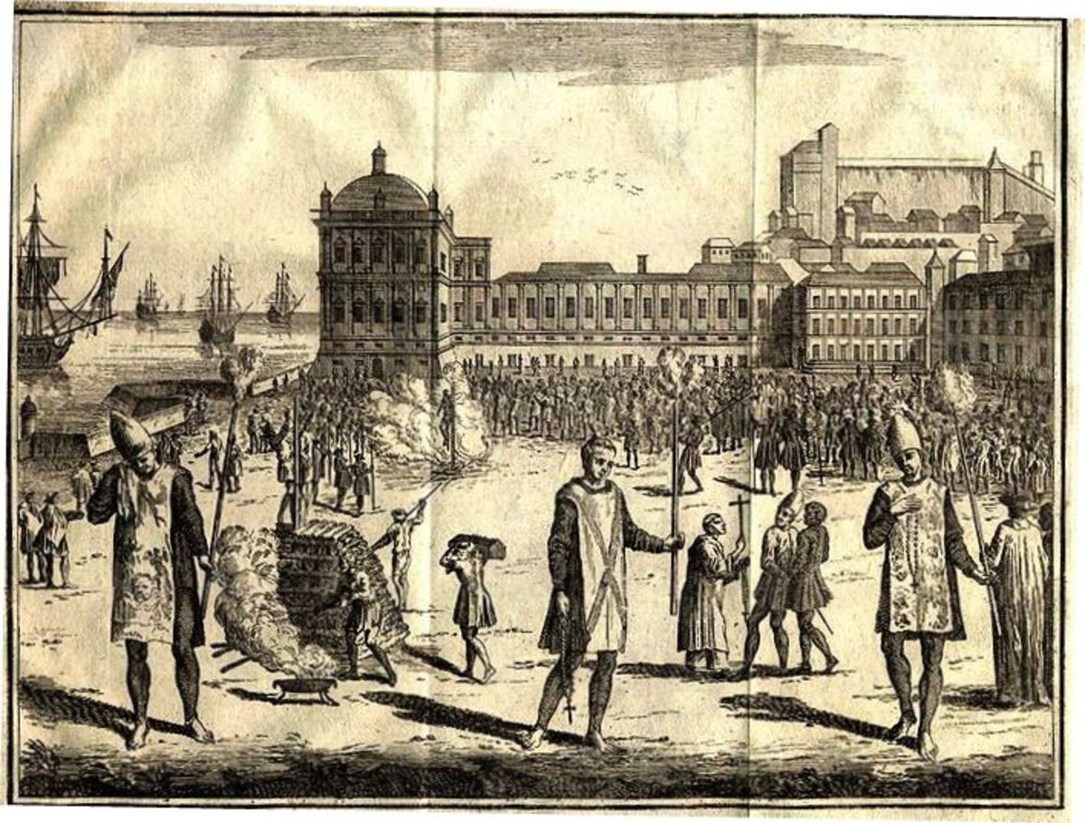 Spanish Inquisitors burn male and female witches. Click to enlarge.