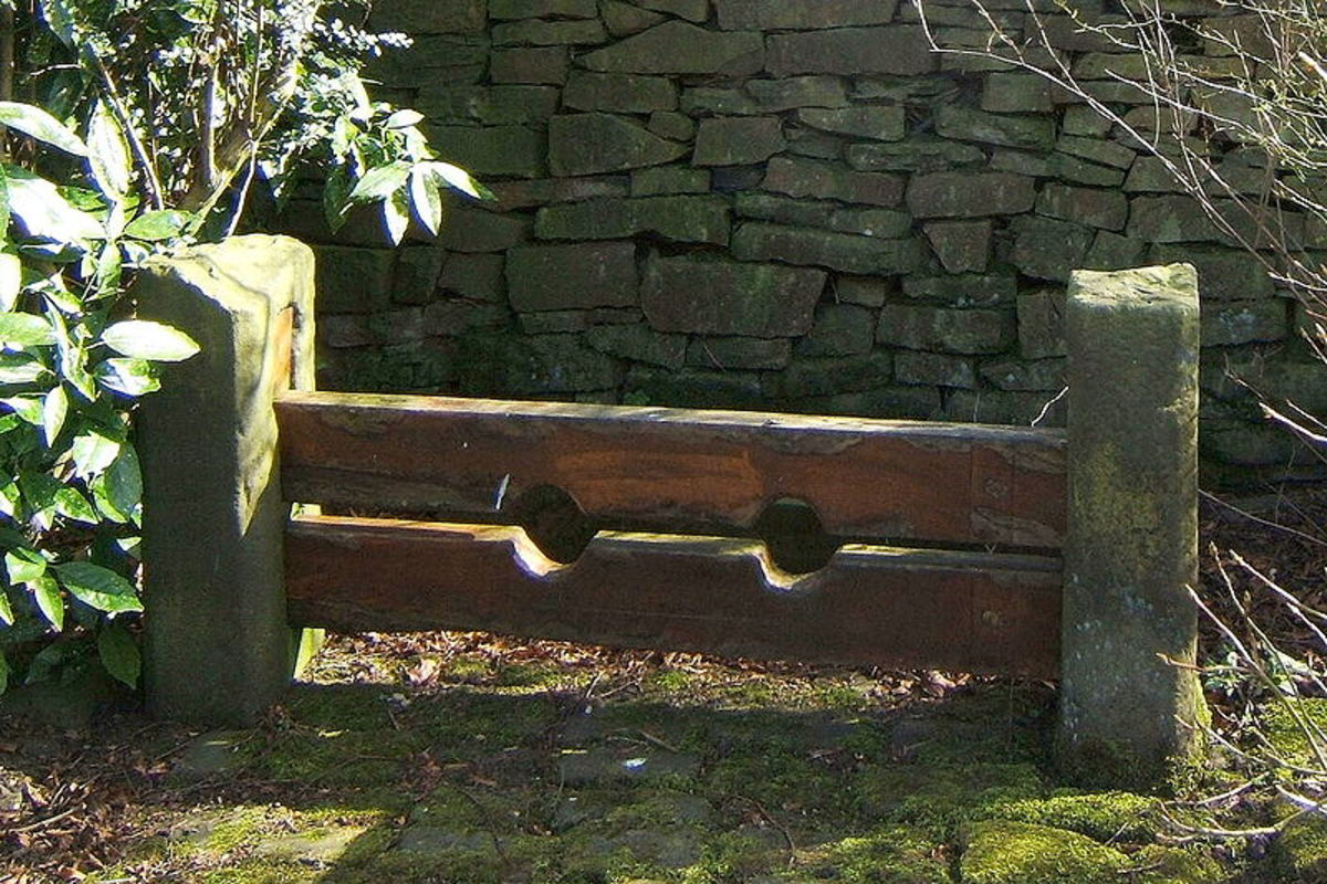 Old Stocks at Chapeltown, Lancashire, UK. The prisoner was required to kneel or lie down, face up or face down, in these stocks.
