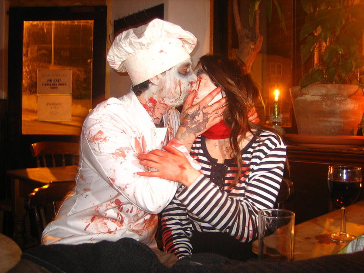 These two zombies love each others' fake wounds!