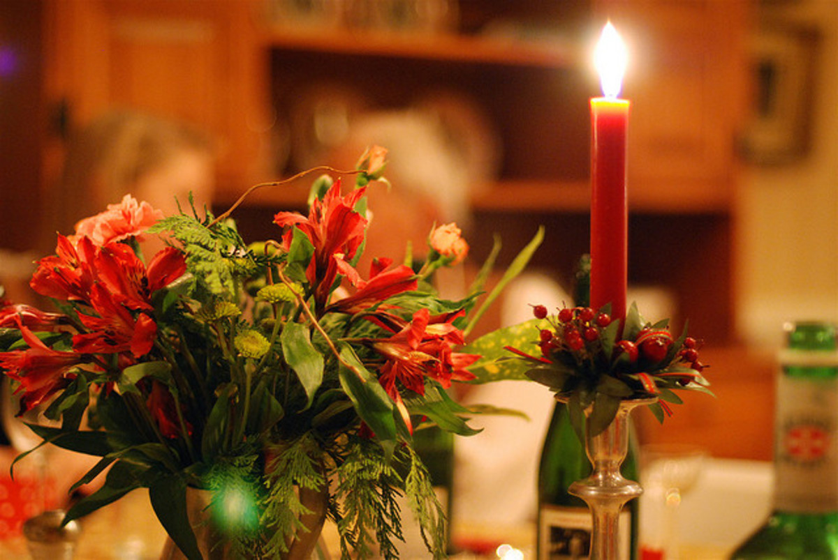 Candles give a warm glow to a holiday table