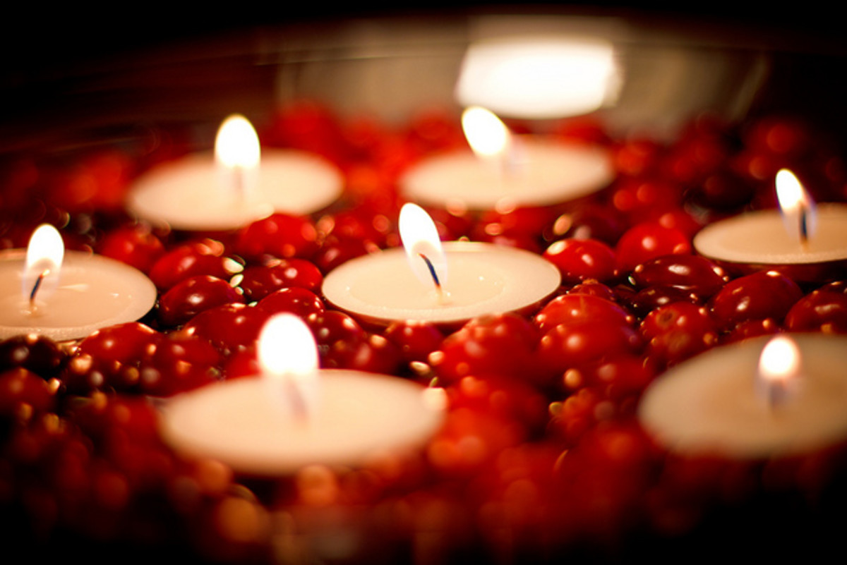Candles positioned in cranberries make a beautiful Thanksgiving decoration