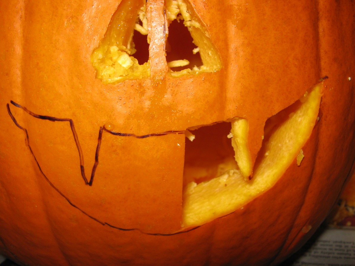 Outline your pumpkin's ghoulish face with a water-soluble marker, then begin chipping away piece by piece.  To keep things easy, just carve one large hole in the side of your pumpkin, and claim it is a mouthless cyclops that breathes through its eye.