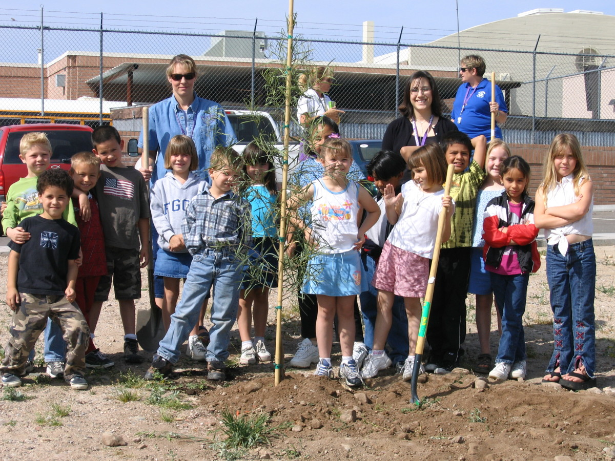 "My daughter's second grade class, 2005, after planting one of the trees they bought with the funds from their ""Kiss the Pig"" penny drive."