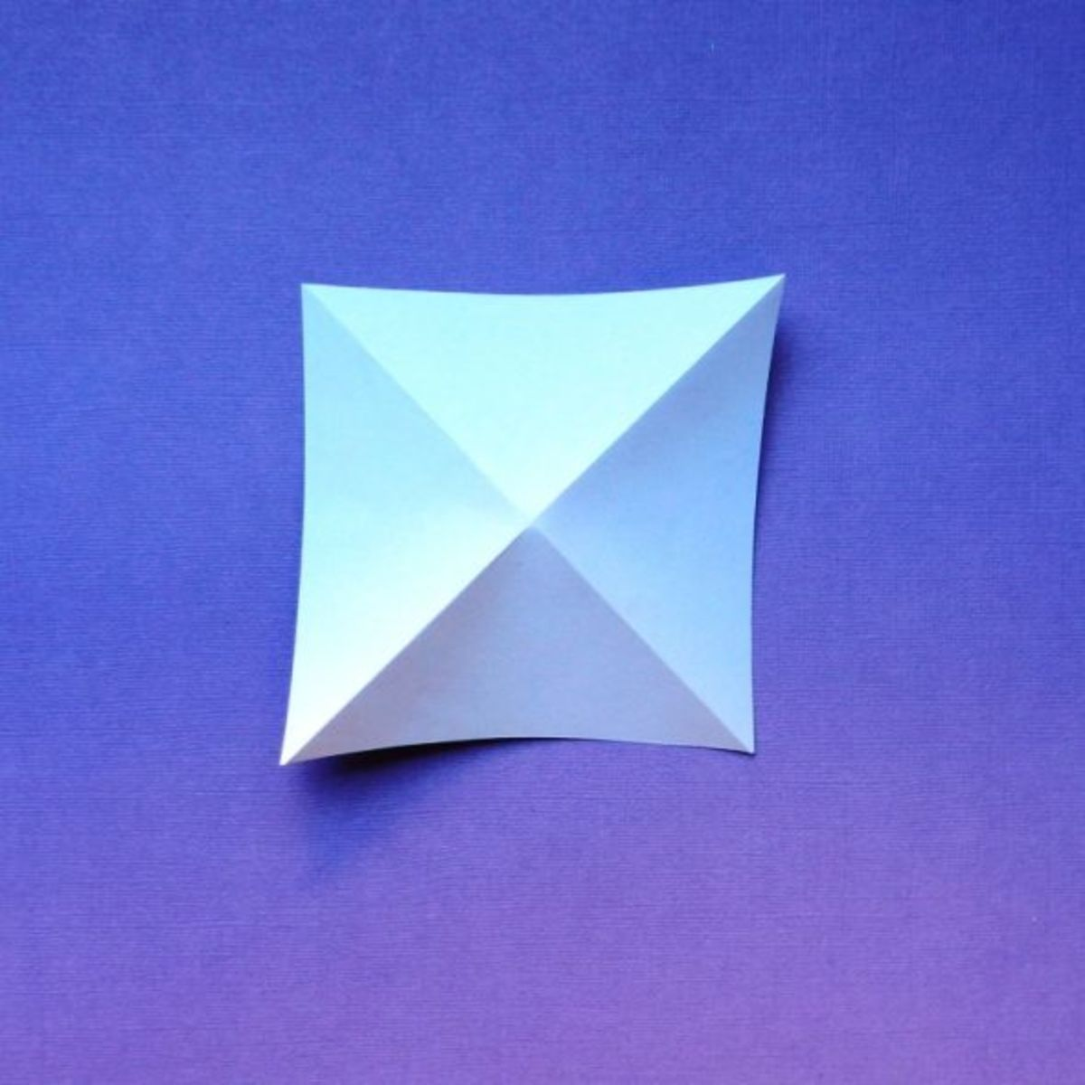 Fold a square two ways diagonally.