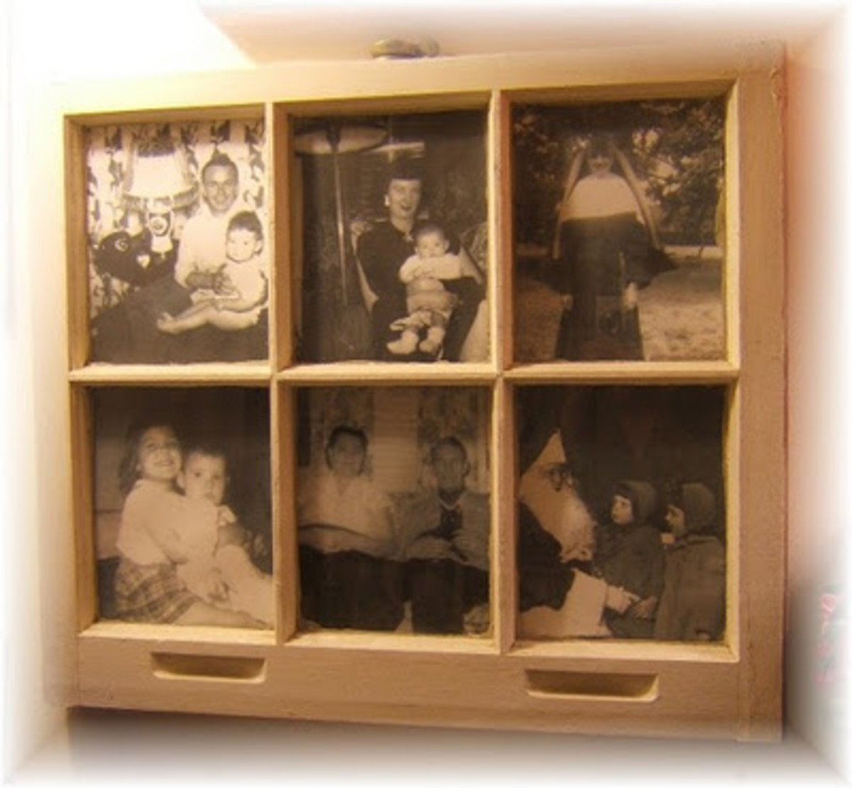 A lovely and unique idea is to display old photos inside vintage window panes