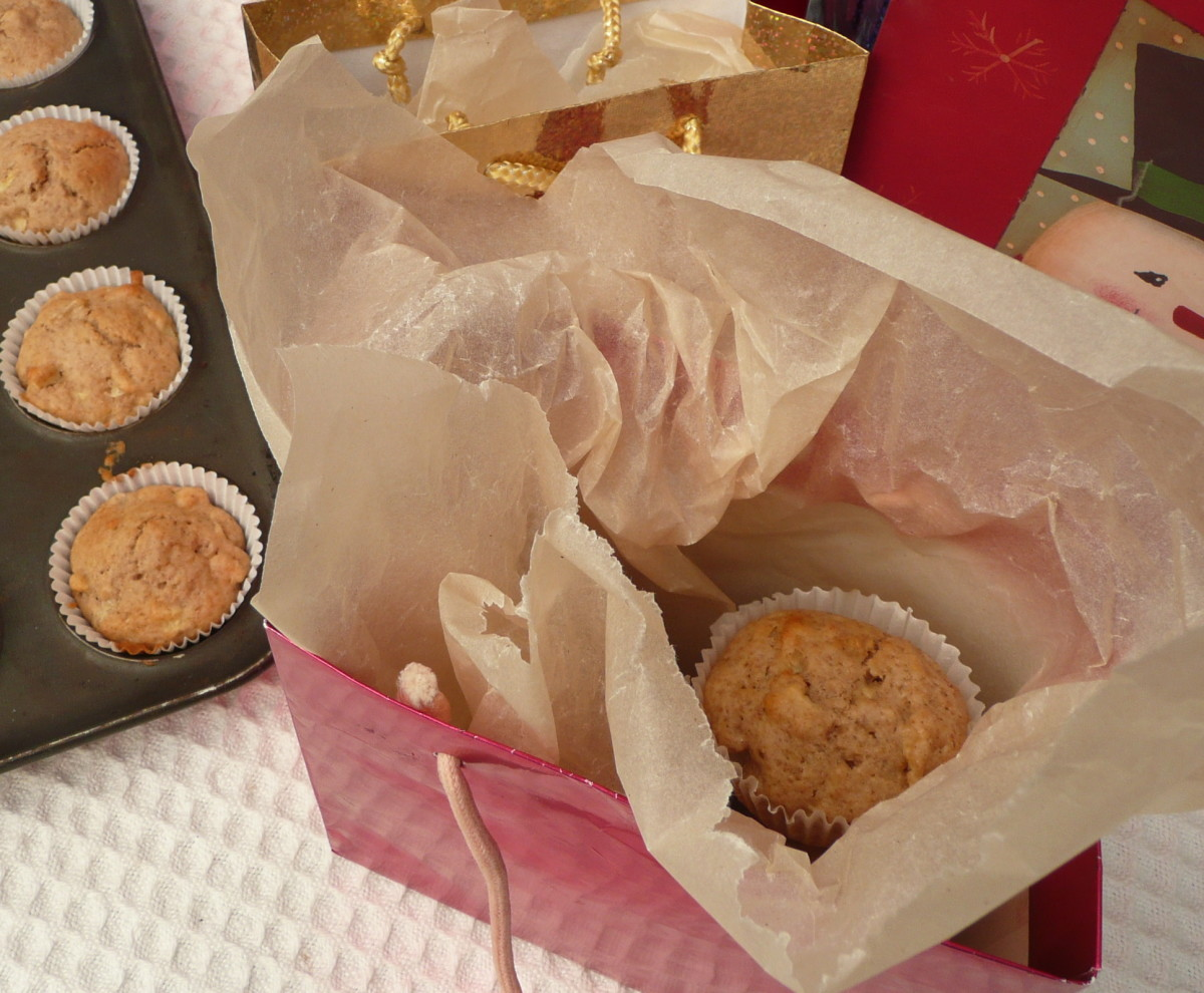 First, place greaseproof paper in you bag. Add muffins.